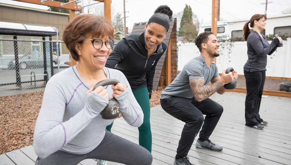 Does Group Fitness Offer More Health Benefits Than Exercising Alone?