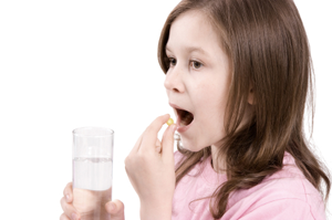 child taking vitamin
