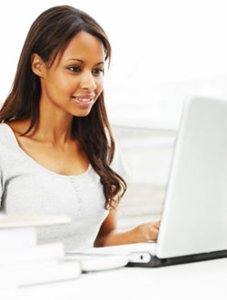 Woman studying on laptop