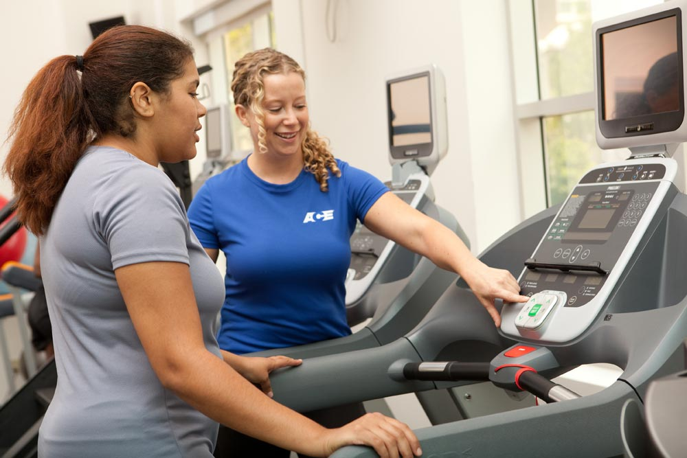 Trainer and client on treadmill