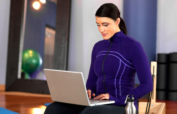 Fitness trainer with laptop