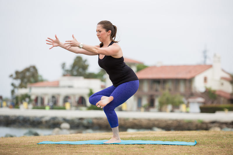 low lunge with foot in hand