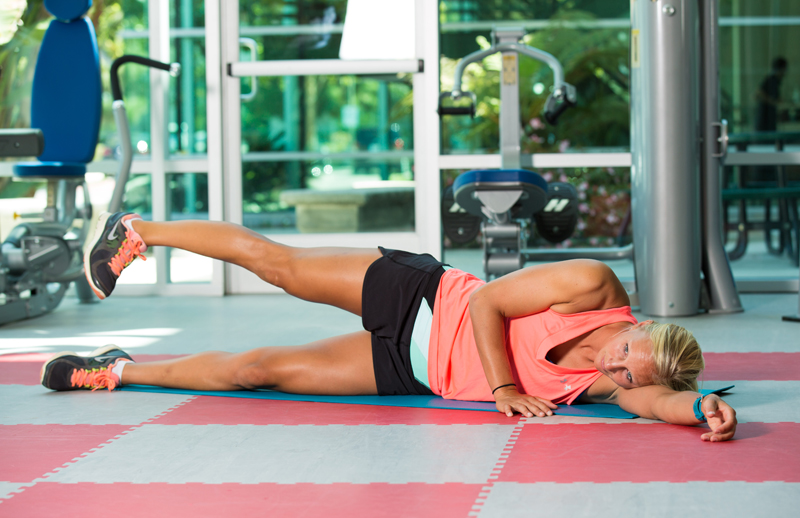 Side leg lift with downward pointed toe