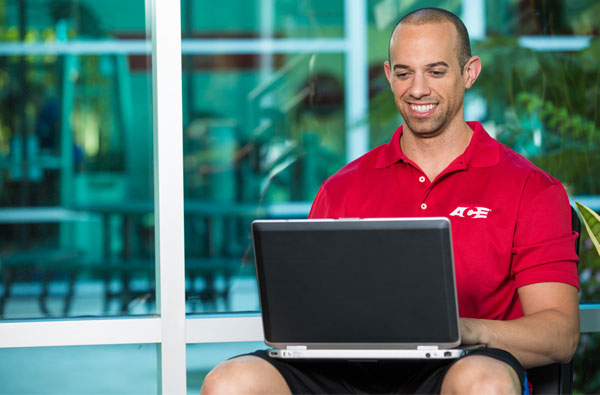 Personal trainer using laptop
